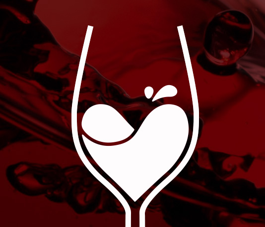 Detail photo of logo symbol for Le Vignoble. A heart within a wine glass